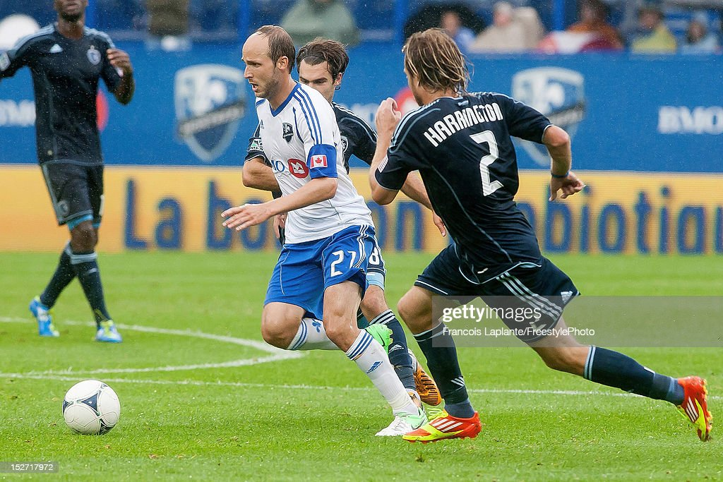 Justin Mapp of the Montreal Impact controls the ball against Michael Harrington of the Sporting KC during the MLS match at Saputo Stadium on...