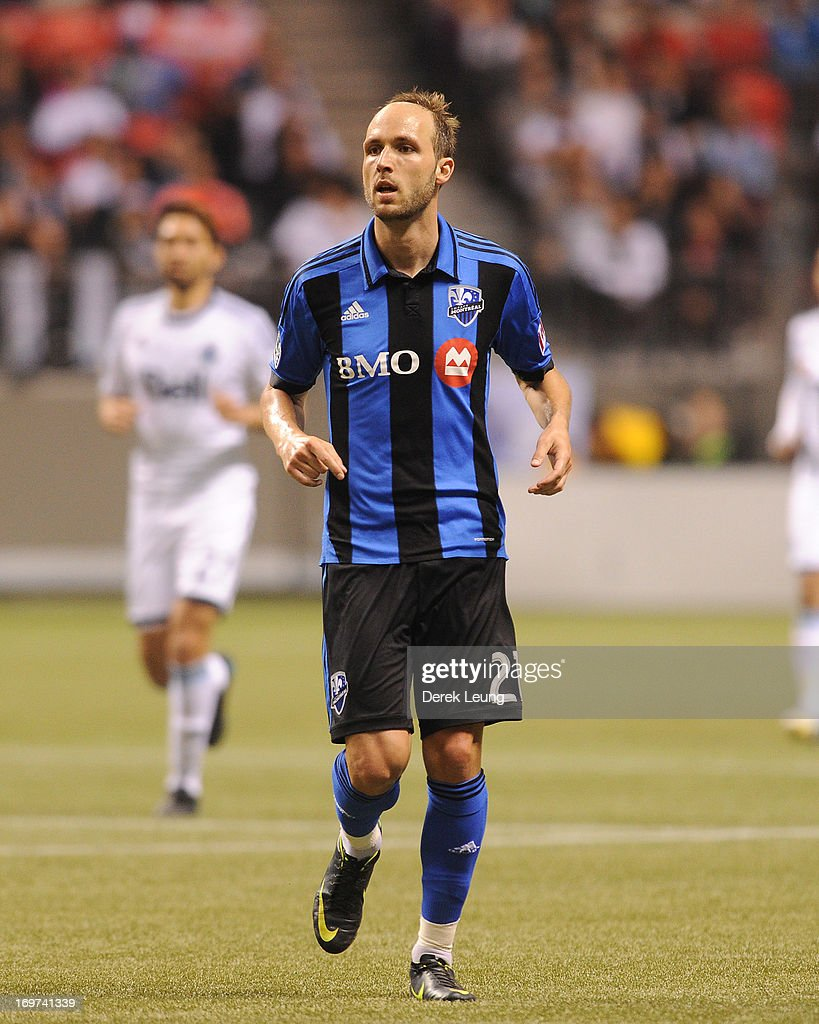 Justin Mapp of the Montreal Impact runs against the Vancouver Whitecaps during the finals of the Amway Canadian Championship at BC Place on May 29...