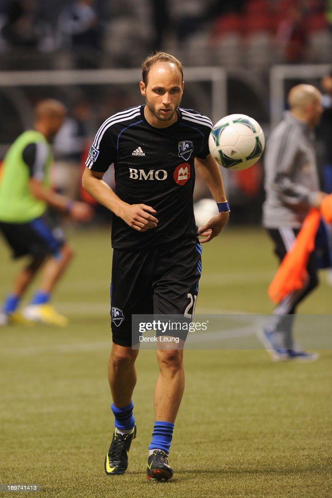 Justin Mapp of the Montreal Impact runs during warmups prior to a match against the Vancouver Whitecaps during the finals of the Amway Canadian...