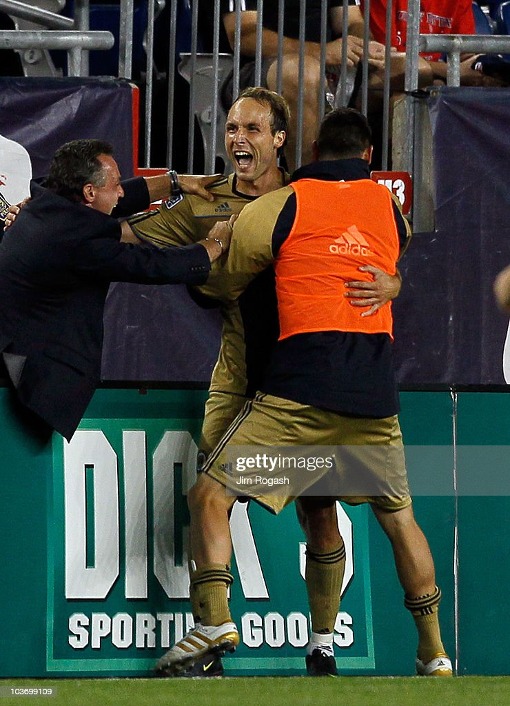 Justin Mapp of the Philadelphia Union is hugged by his coach Peter Nowak after Mapp scored the winning goal against the New England Revolution at...