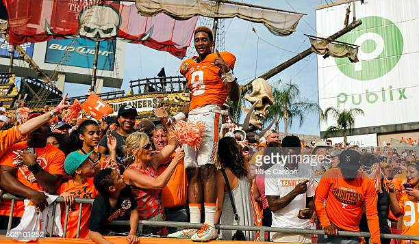 Justin Martin of the Tennessee Volunteers joins fans to celebrate a win over the Northwestern Wildcats in the Outback Bowl at Raymond James Stadium...