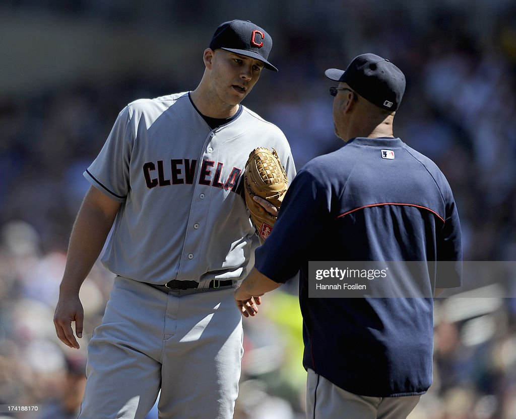 Justin Masterson #63 and Terry Francona #17 of the Cleveland Indians speak on the mound during the seventh inning of the game on July 21, 2013 at Target Field in Minneapolis, Minnesota. The Indians defeated the Twins 7-1.