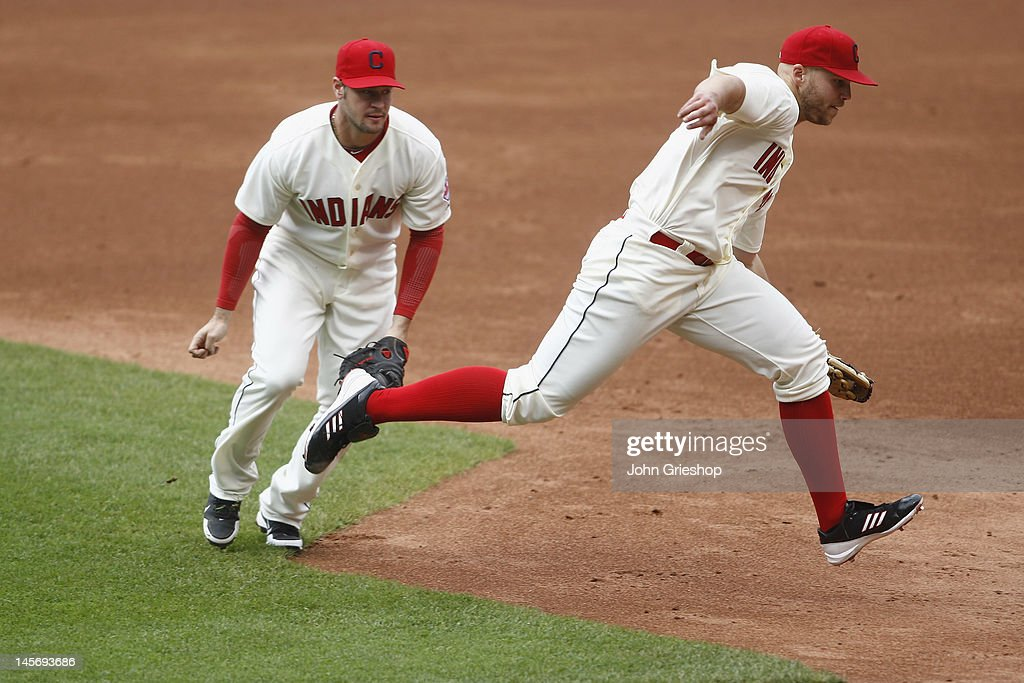 Justin Masterson makes the play on the ball in front of Matt LaPorta of the Cleveland Indians during their game against the Minnesota Twins at...