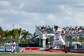 Justin Masterson of the Boston Red Sox pitches in the first inning of the game against the Miami Marlins at Jet Blue Park on March 6 2015 in Fort...