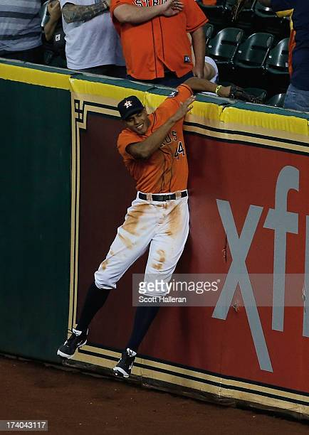 Justin Maxwell of the Houston Astros cannot make a play in right field on a three run home run hit by Brad Miller of the Seattle Mariners at Minute...