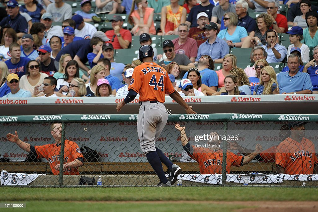 Justin Maxwell #44 of the Houston Astros is greeted after scoring the go-ahead run against the Chicago Cubs during the ninth inning on June 22, 2013 at Wrigley Field in Chicago, Illinois.