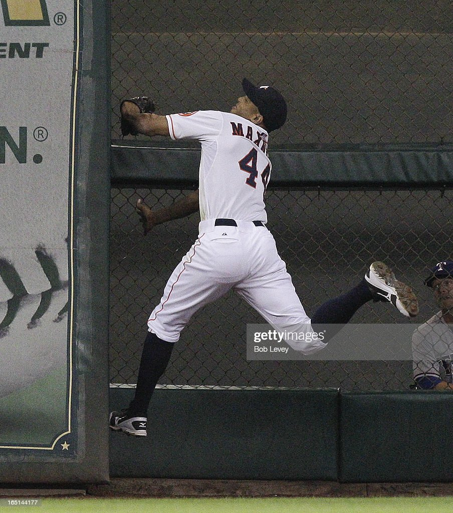 Justin Maxwell #44 of the Houston Astros makes a running catch on a ball hit to the wall by David Murphy #7 of the Texas Rangers in the ninth inning at Minute Maid Park on March 31, 2013 in Houston, Texas.