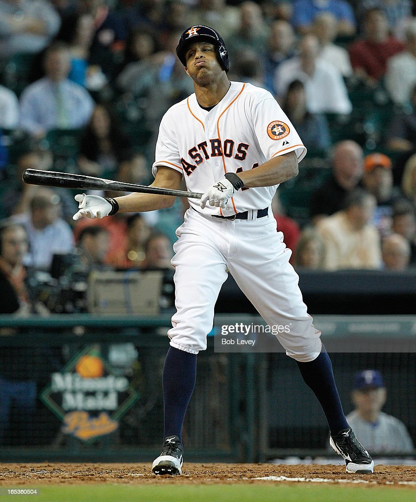 Justin Maxwell #44 of the Houston Astros reacts after striking out in the second inning against the Texas Rangers at Minute Maid Park on April 3, 2013 in Houston, Texas.