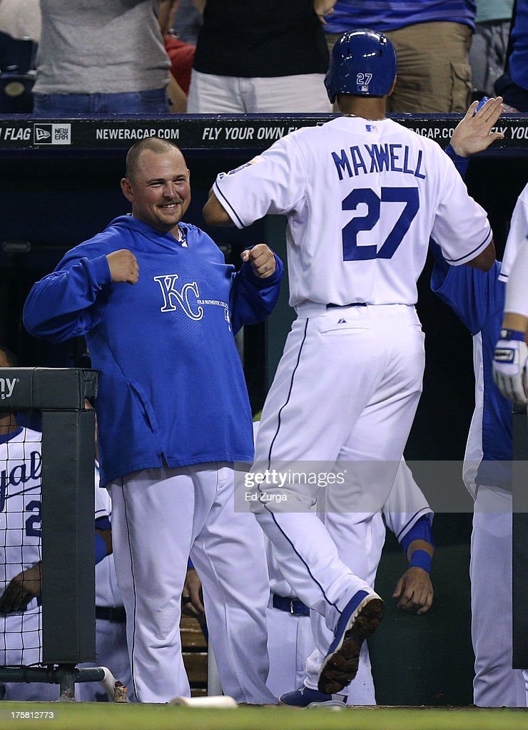 Justin Maxwell #27 of the Kansas City Royals celebrates his home run with <a gi-track='captionPersonalityLinkClicked' href=/galleries/search?phrase=Billy+Butler&family=editorial&specificpeople=759092 ng-click='$event.stopPropagation()'>Billy Butler</a> #16 in the eighth inning during a game against the Boston Red Sox at Kauffman Stadium August, 8, 2013 in Kansas City, Missouri.