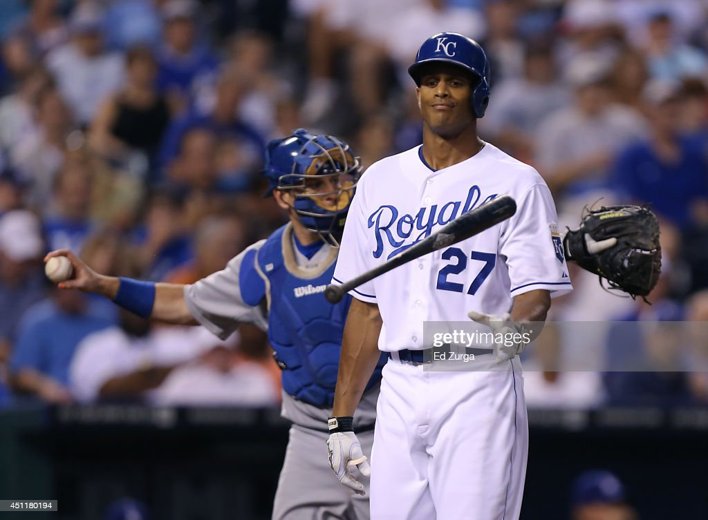 Justin Maxwell #27 of the Kansas City Royals flips his bat after striking out in the fifth inning against Clayton Kershaw of the Los Angeles Dodgersat Kauffman Stadium on June 24, 2014 in Kansas City, Missouri.