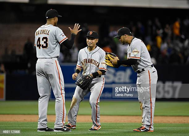 Justin Maxwell of the San Francisco Giants left Nori Aoki center and Gregor Blanco right celebrate after beating the San Diego Padres 10 in the home...