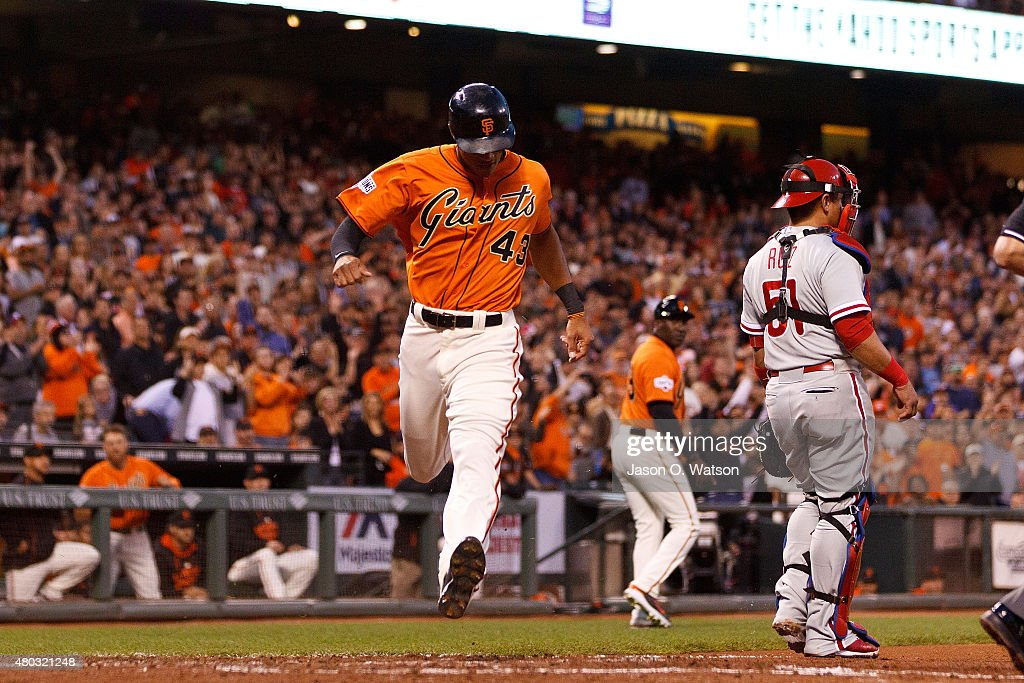 Justin Maxwell of the San Francisco Giants scores a run past Carlos Ruiz of the Philadelphia Phillies during the fourth inning at ATT Park on July 10...