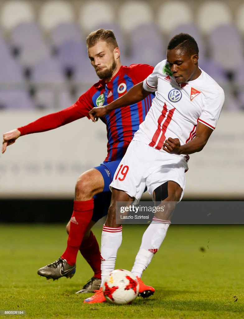 Justin Mengolo #19 of DVSC scores next to Vit Benes (L) of Vasas FC during the Hungarian OTP Bank Liga match between Vasas FC and DVSC at Ferenc Szusza Stadium on November 25, 2017 in Budapest, Hungary.