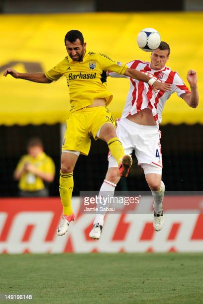 Justin Meram of the Columbus Crew and Robert Huth of Stoke City FC battle for control of the ball in the first half on July 24 2012 at Crew Stadium...