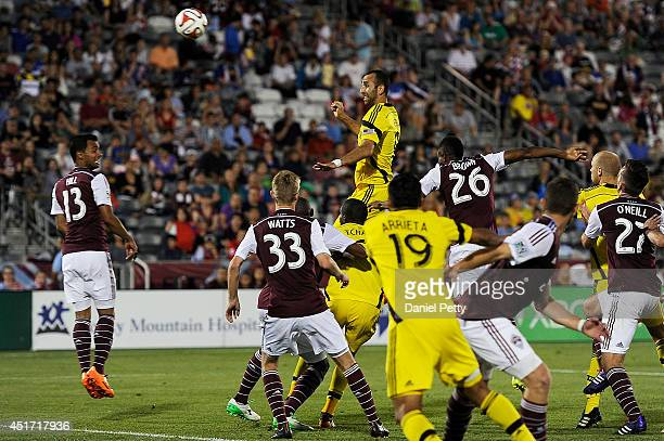 Justin Meram of the Columbus Crew goes up for a header off a corner kick during an MLS match against the Colorado Rapids at Dick's Sporting Goods...