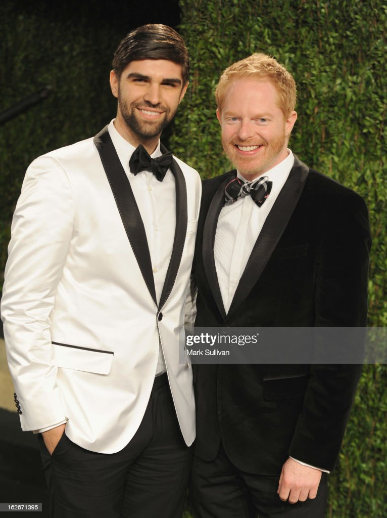Justin Mikita (L) and actor Jesse Tyler Ferguson arrive at the 2013 Vanity Fair Oscar Party at Sunset Tower on February 24, 2013 in West Hollywood, California.