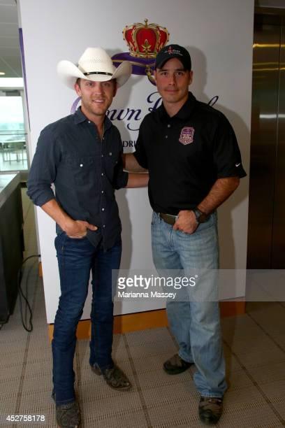 Justin Moore and Green Beret John Wayne Walding pose at Indianapolis Motor Speedway Walding received the naming rights to Sunday's NASCAR Sprint Cup...