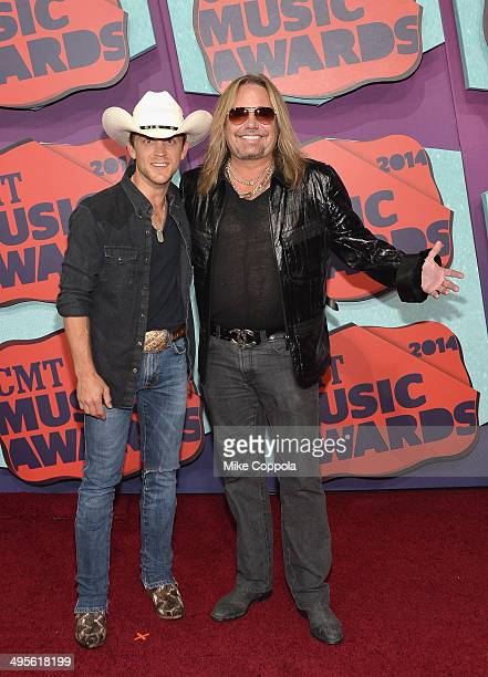 Justin Moore and Vince Neil attend the 2014 CMT Music awards at the Bridgestone Arena on June 4 2014 in Nashville Tennessee