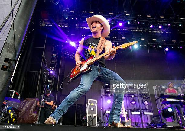 Justin Moore performs on day 2 of the Faster Horses Festival at Michigan International Speedway on July 18 2015 in Brooklyn Michigan