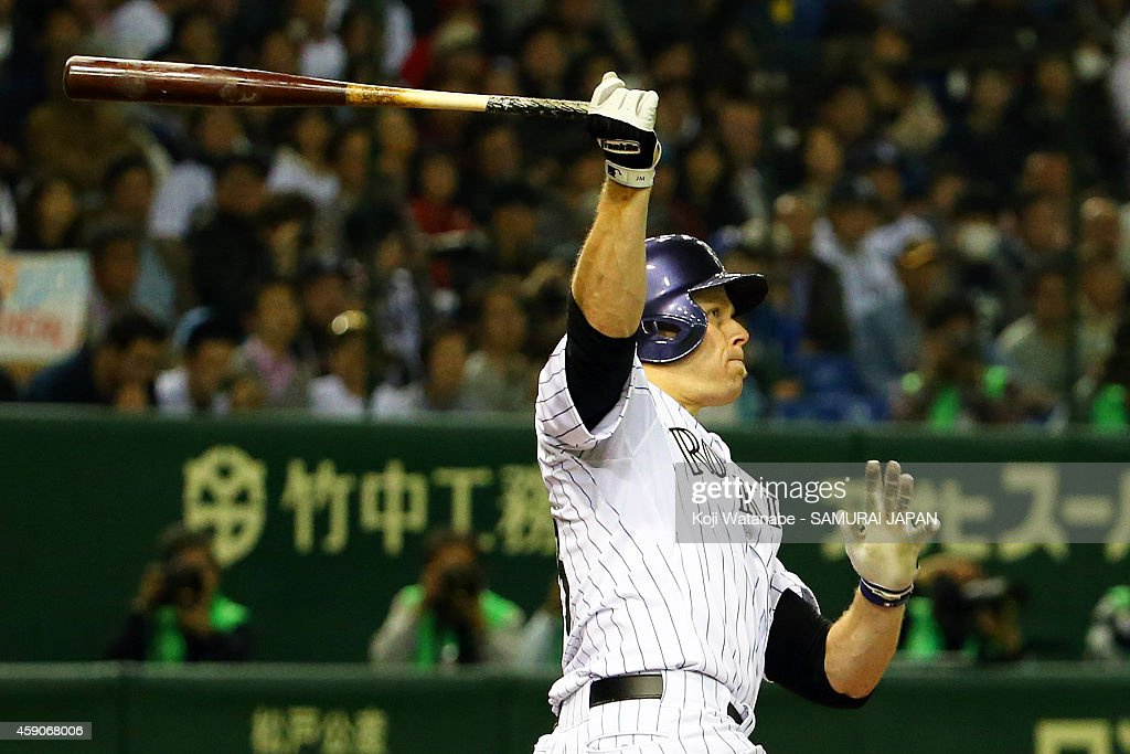 Justin Morneau (R) #33 of the Colorado Rockies hits a three-run homer in the third inning during the game four of Samurai Japan and MLB All Stars at Tokyo Dome on November 16, 2014 in Tokyo, Japan.