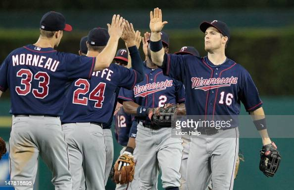 Justin Morneau and Josh Willingham of the Minnesota Twins celebrates a win over the Detroit Tigers at Comerica Park on July 3 2012 in Detroit...