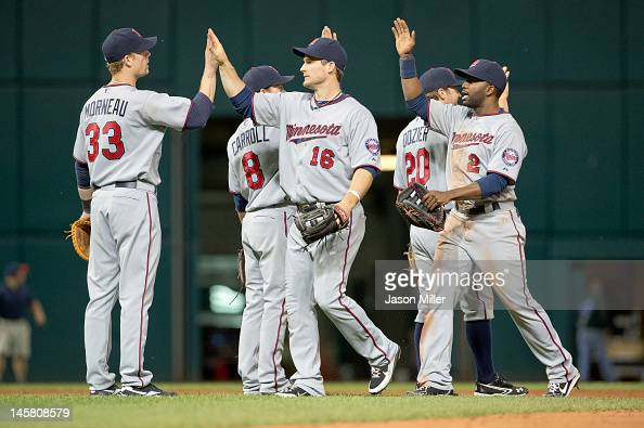 Justin Morneau Jamey Carroll Josh Willingham Brian Dozier and Denard Span celebrate after defeating the Cleveland Indians at Progressive Field on...