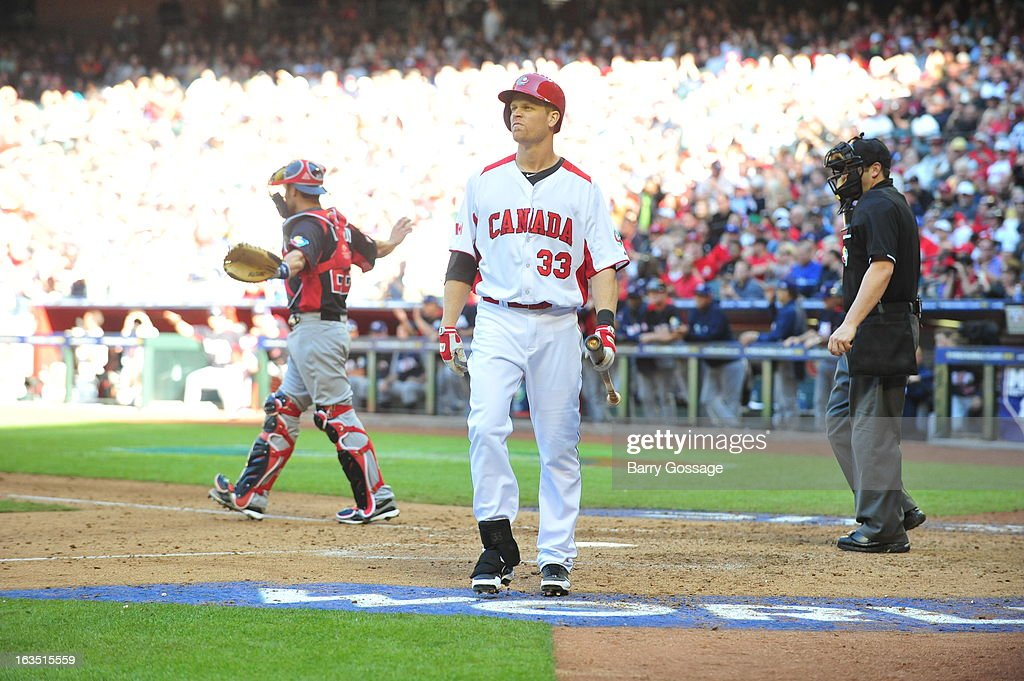 Justin Morneau #33 of Team Canada walks to the dugout after striking out in the 8th inning during Pool D, Game 6 between the United States and Canada during the first round of the 2013 World Baseball Classic at Chase Field on March 10, 2013 in Phoenix, Arizona.