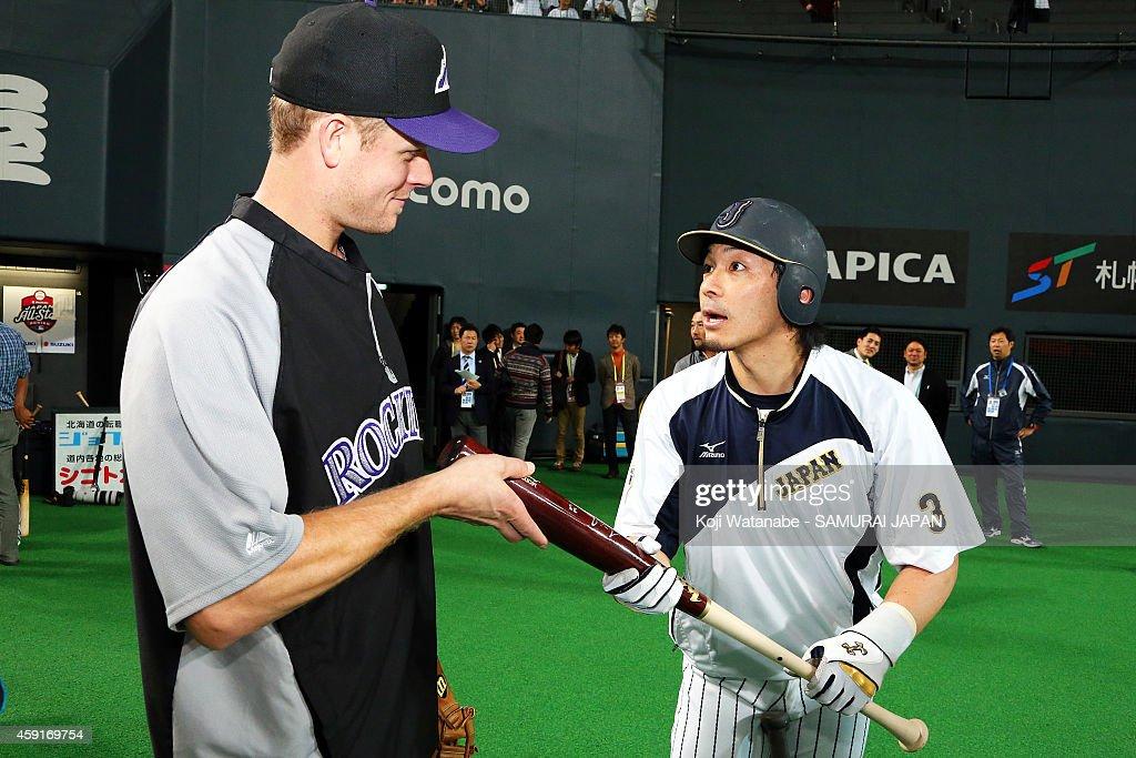 Justin Morneau of the Colorado Rockies and Nobuhiro Matsuda of Samurai Japan talk prior to the game five of Samurai Japan and MLB All Stars at...