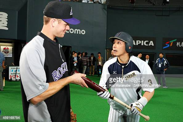 Justin Morneau of the Colorado Rockies and Nobuhiro Matsuda of Samurai Japan talk prior to the game five of Samurai Japan and MLB All Stars at...