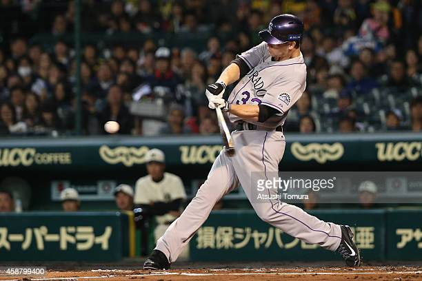 Justin Morneau of the Colorado Rockies bats during the friendly match between Hanshin Tigers and Yomiuri Giants at the Hanshin Koshien Stadium on...