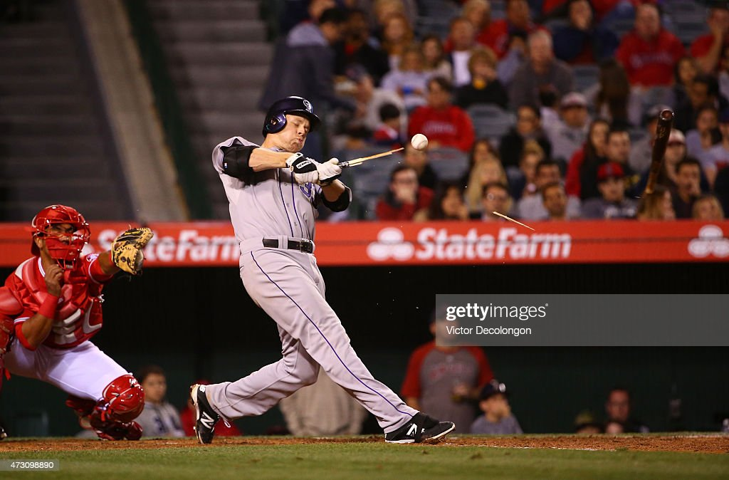 Justin Morneau #33 of the Colorado Rockies breaks his bat during his at-bat in the sixth inning during the MLB game against the Los Angeles Angels of Anaheim at Angel Stadium of Anaheim on May 12, 2015 in Anaheim, California.