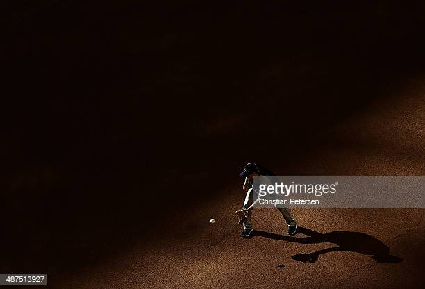 Justin Morneau of the Colorado Rockies fields a ground ball during warm ups to the MLB game against the Arizona Diamondbacks at Chase Field on April...