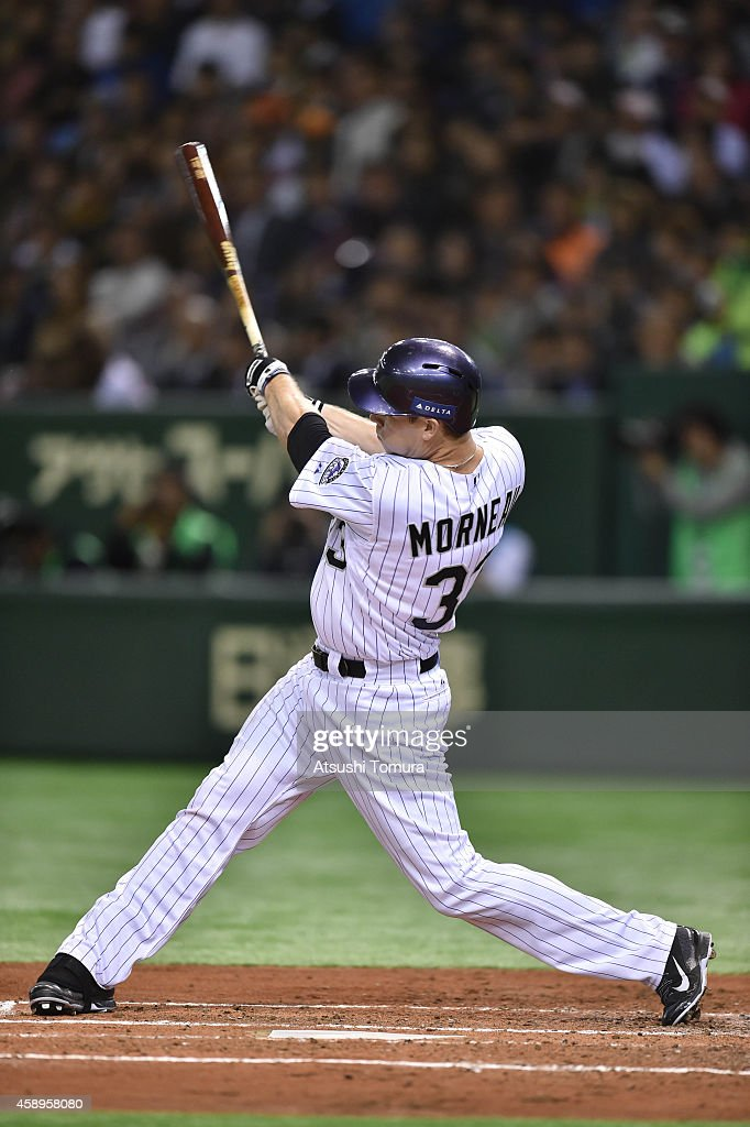 Justin Morneau #33 of the Colorado Rockies hits two-run homer in the second inning during the game two of Samurai Japan and MLB All Stars at Tokyo Dome on November 14, 2014 in Tokyo, Japan.
