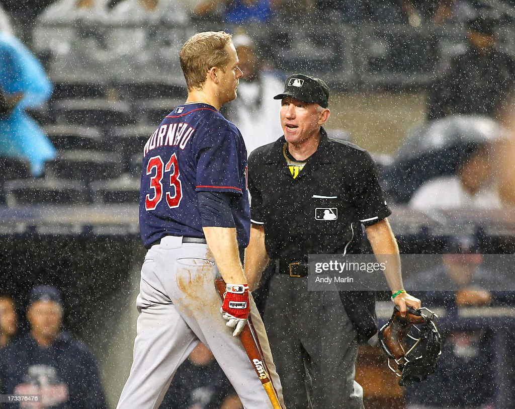 <a gi-track='captionPersonalityLinkClicked' href=/galleries/search?phrase=Justin+Morneau&family=editorial&specificpeople=211556 ng-click='$event.stopPropagation()'>Justin Morneau</a> #33 of the Minnesota Twins argues a call after striking out with two men in scoring position in the top of the seventh inning against the New York yankees at Yankee Stadium on July 12, 2013 in the Bronx borough of New York City.