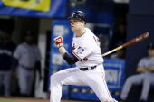 Justin Morneau of the Minnesota Twins bats against the Seattle Mariners on May 9 2009 at the Metrodome in Minneapolis Minnesota The Twins won 96