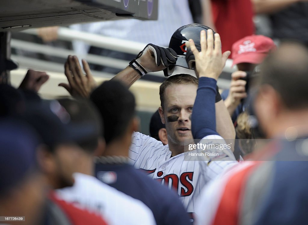 Justin Morneau #33 of the Minnesota Twins celebrates a two run home run against the Texas Rangers during the sixth inning of the game on April 28, 2013 at Target Field in Minneapolis, Minnesota. The Twins defeated the Ranger 5-0.