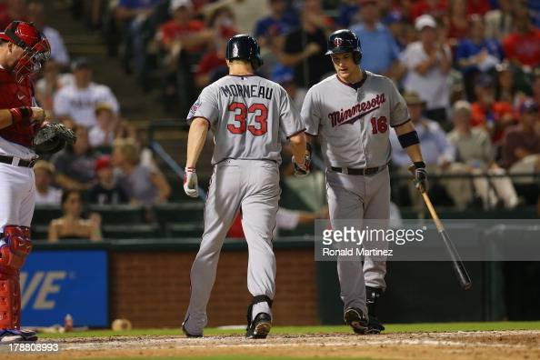 Justin Morneau of the Minnesota Twins celebrates hitting a homerun against the Texas Rangers with Josh Willingham in the 7th inning at Rangers...