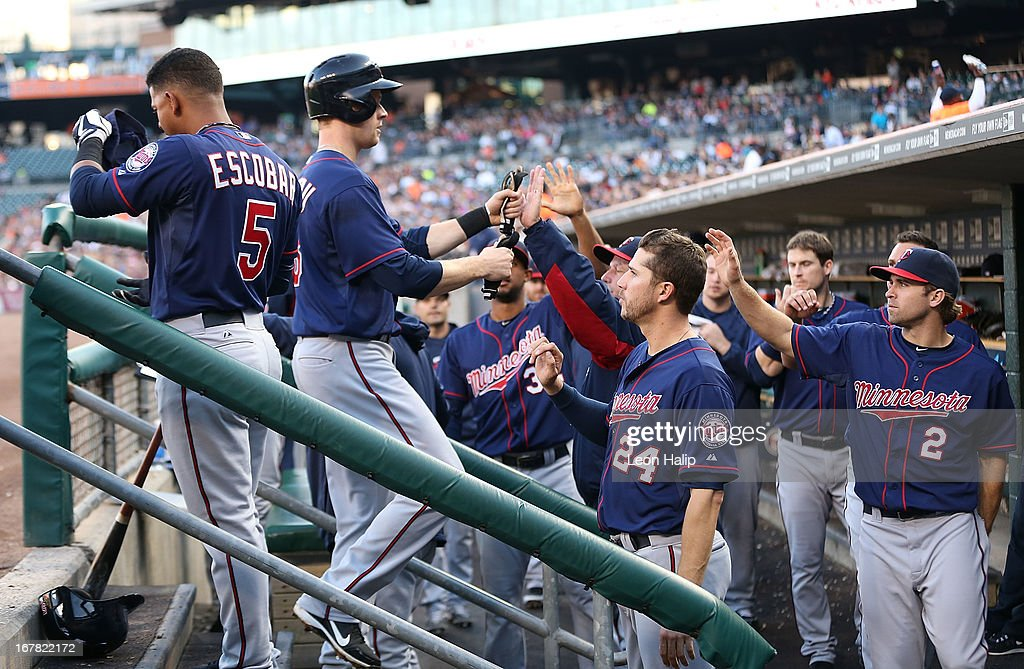 <a gi-track='captionPersonalityLinkClicked' href=/galleries/search?phrase=Justin+Morneau&family=editorial&specificpeople=211556 ng-click='$event.stopPropagation()'>Justin Morneau</a> #33 of the Minnesota Twins celebrates with his teammates after scoring on the double by Wilkin Ramirez #22 in the second inning during the game against the Detroit Tigers at Comerica Park on April 30, 2013 in Detroit, Michigan. The Tigers defeated the Twins 6-1.