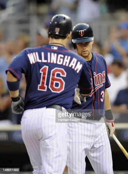 Justin Morneau of the Minnesota Twins congratulates Josh Willingham on a solo home run against the Baltimore Orioles during the fourth inning on July...