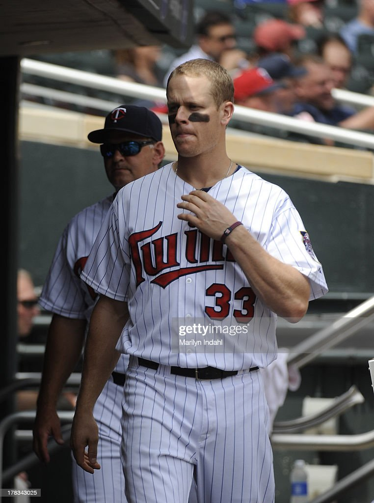 <a gi-track='captionPersonalityLinkClicked' href=/galleries/search?phrase=Justin+Morneau&family=editorial&specificpeople=211556 ng-click='$event.stopPropagation()'>Justin Morneau</a> #33 of the Minnesota Twins in the dugout during the third inning against the Kansas City Royals at Target Field on August 29, 2013 in Minneapolis, Minnesota. The Royals defeated the Twins 3-1.