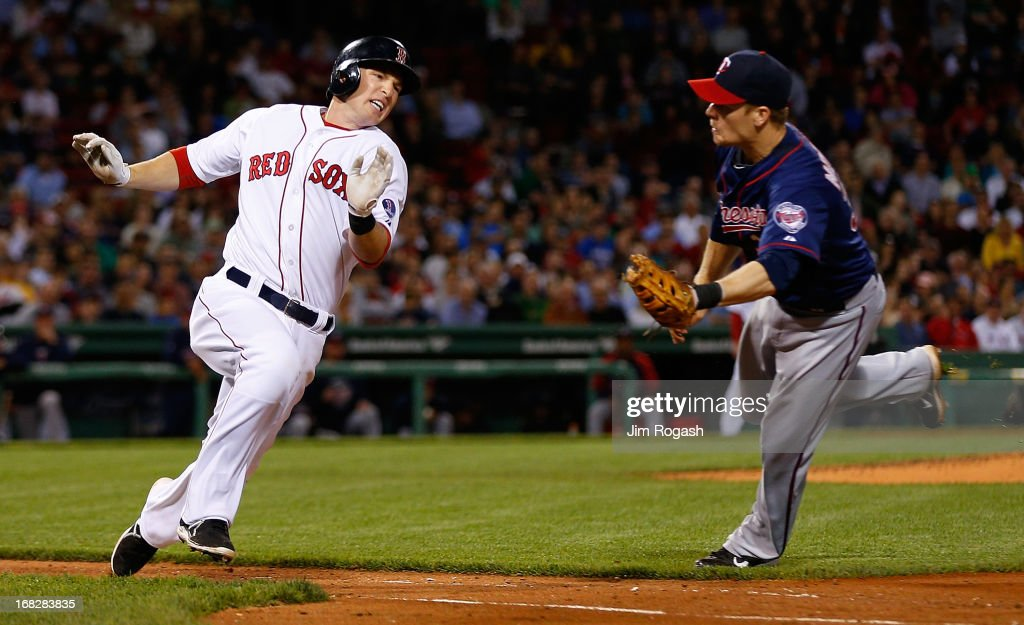 Justin Morneau #33 of the Minnesota Twins reaches to tag out Stephen Drew #7 of the Boston Red Sox trying to leg out an infield hit in the 5th inning at Fenway Park on May 7, 2013 in Boston, Massachusetts.