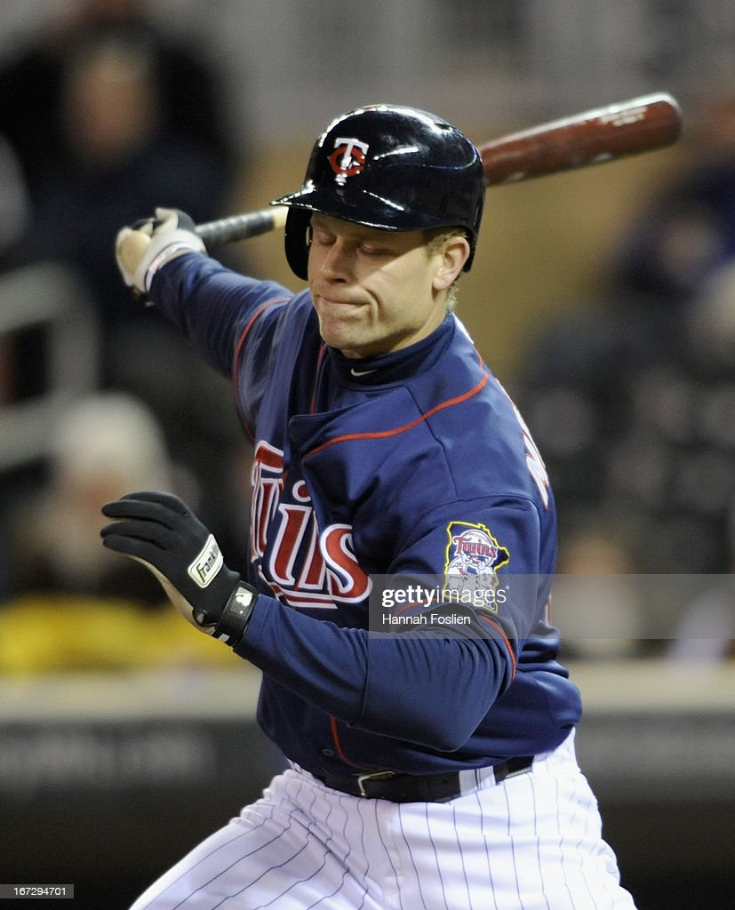 Justin Morneau #33 of the Minnesota Twins reacts to striking out against the Miami Marlins during the fifth inning of the second game of a doubleheader on April 23, 2013 at Target Field in Minneapolis, Minnesota.