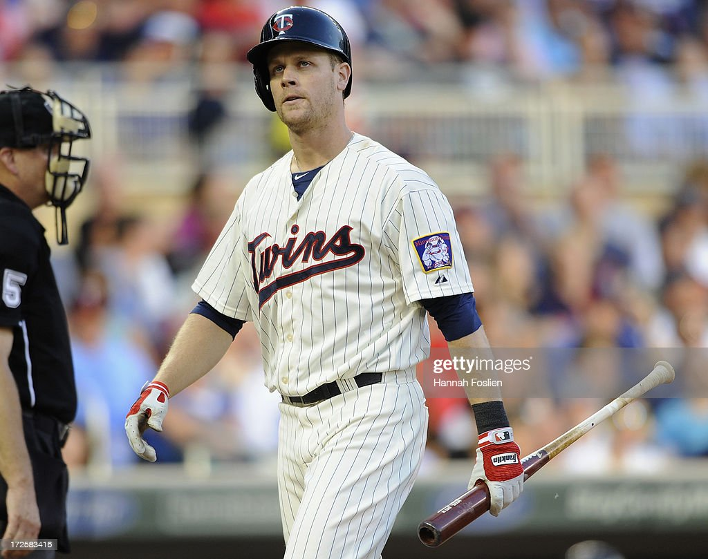 Justin Morneau #33 of the Minnesota Twins reacts to striking out against the New York Yankees during the third inning of the game on July 3, 2013 at Target Field in Minneapolis, Minnesota. The Yankees defeated the Twins 3-2.