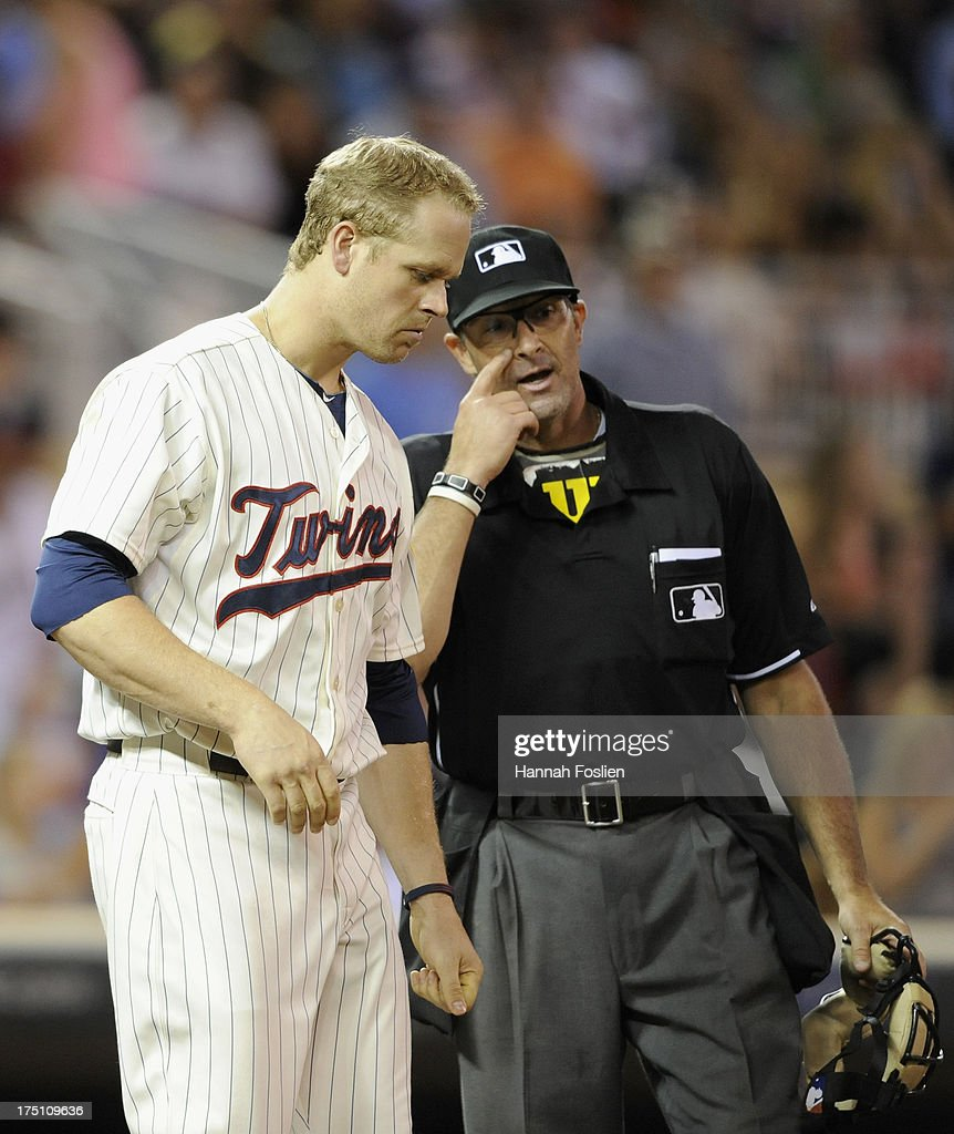 <a gi-track='captionPersonalityLinkClicked' href=/galleries/search?phrase=Justin+Morneau&family=editorial&specificpeople=211556 ng-click='$event.stopPropagation()'>Justin Morneau</a> #33 of the Minnesota Twins reacts to striking out against the Kansas City Royals during the seventh inning of the game on July 31, 2013 at Target Field in Minneapolis, Minnesota. The Royals defeated the Twins 4-3.