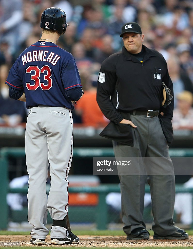 Justin Morneau #33 of the Minnesota Twins reacts to the homeplate umpire Chad Fairchild after being called out on strikes in the third inning of the game against the Detroit Tigers during the game at Comerica Park on April 30, 2013 in Detroit, Michigan. The Tigers defeated the Twins 6-1.