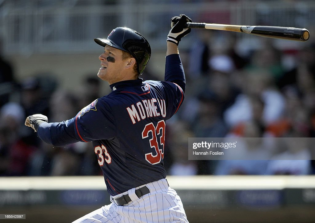 <a gi-track='captionPersonalityLinkClicked' href=/galleries/search?phrase=Justin+Morneau&family=editorial&specificpeople=211556 ng-click='$event.stopPropagation()'>Justin Morneau</a> #33 of the Minnesota Twins singles against the Detroit Tigers during the sixth inning of the game on April 4, 2013 at Target Field in Minneapolis, Minnesota. The Twins defeated the Tigers 8-2.