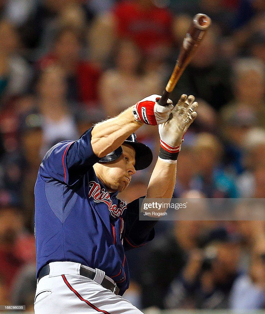 <a gi-track='captionPersonalityLinkClicked' href=/galleries/search?phrase=Justin+Morneau&family=editorial&specificpeople=211556 ng-click='$event.stopPropagation()'>Justin Morneau</a> #33 of the Minnesota Twins singles in a run in the 8th inning against the Boston Red Sox at Fenway Park on May 7, 2013 in Boston, Massachusetts.
