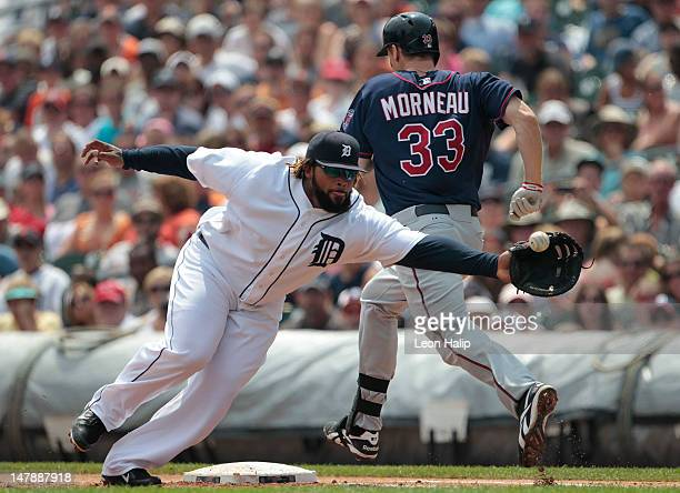 Justin Morneau of the Minnnesota Twins beats the throw to first base as Prince Fielder of the Detroit Tigers stretches to make the play during the...