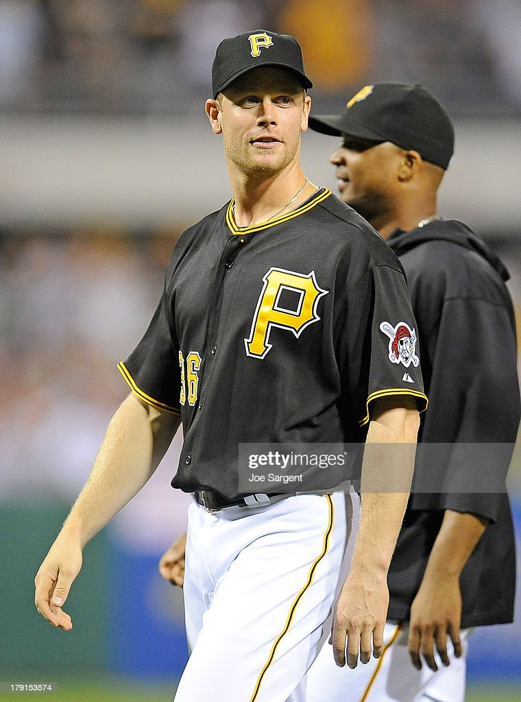 <a gi-track='captionPersonalityLinkClicked' href=/galleries/search?phrase=Justin+Morneau&family=editorial&specificpeople=211556 ng-click='$event.stopPropagation()'>Justin Morneau</a> #36 of the Pittsburgh Pirates walks off the field after the game against the St. Louis Cardinals on August 31, 2013 at PNC Park in Pittsburgh, Pennsylvania.