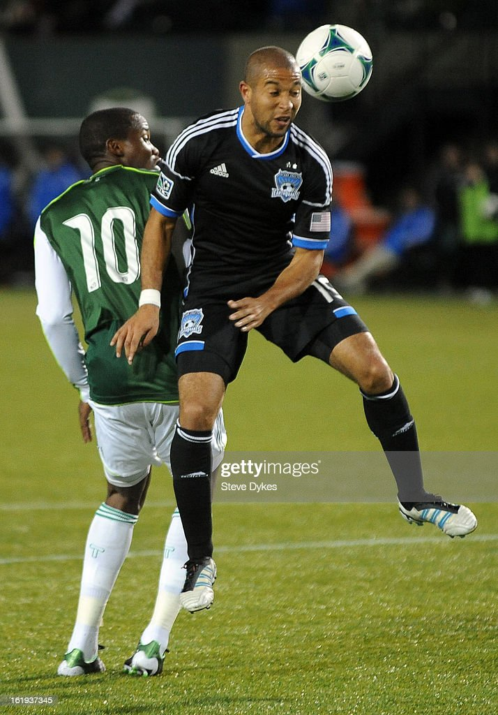 Justin Morrow #15 of San Jose Earthquakes heads the ball away from <a gi-track='captionPersonalityLinkClicked' href=/galleries/search?phrase=Danny+Mwanga&family=editorial&specificpeople=6691917 ng-click='$event.stopPropagation()'>Danny Mwanga</a> #10 of Portland Timbers during the second half of the game at Jeld-Wen Field on February 17, 2013 in Portland, Oregon. The game ended in a 3-3 draw.Photo by Steve Dykes/Getty Images)
